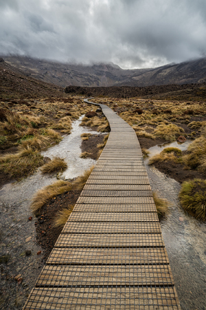 Wooden boardwalk in Tongariro national park, New Zealand Stok Fotoğraf - 70180365