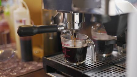 Coffee machine work drip.Coffee maker with coffee cup. Archivio Fotografico