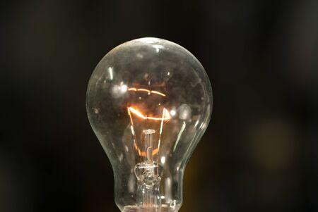 Light bulb on black background.Light bulb turning on and off on black background.