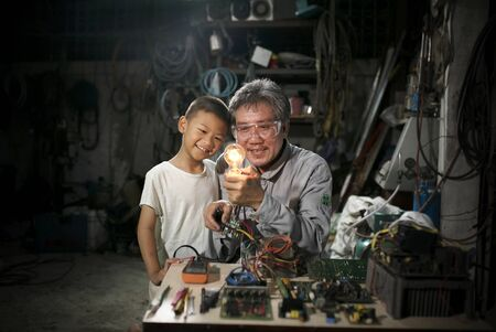 Happy cute boy to learn with his grandfater.It is interesting to learn. Archivio Fotografico