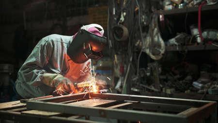 Worker welding the steel structure,craftsman, erecting technical steel Industrial steel welder in factory technical Archivio Fotografico