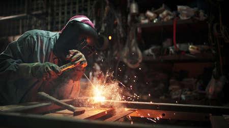 Worker welding the steel structure,craftsman, erecting technical steel Industrial steel welder in factory technical. Archivio Fotografico