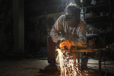 Manual Worker cut steel with gas Cutting Machine on Steel Plate.