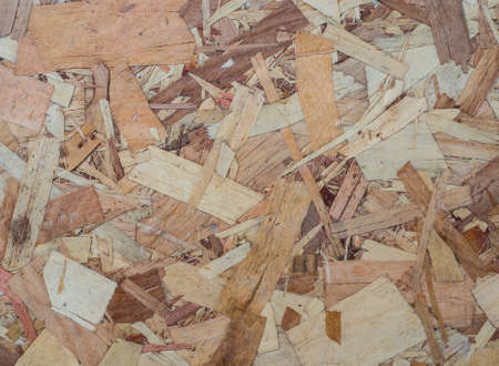 pressing: Brown and light brown old plywood by pressing