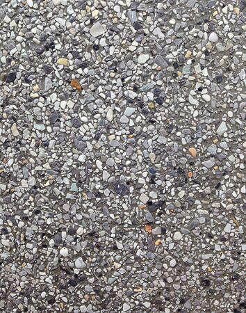 white pebble: Closeup black and white pebble cement wall texture