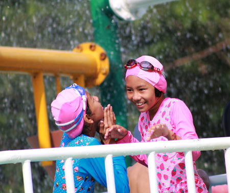 Two girls is play water park