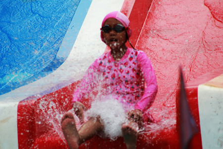 slider: The child playing a slider
