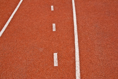 Track red and white lines divide the box for the tournament photo