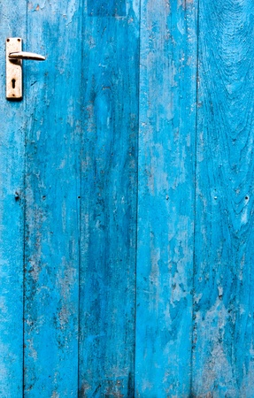 The doors made ​​of wood painted blue photo