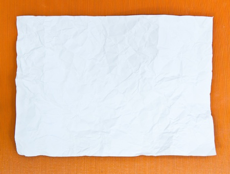 Sheet of white paper on the floor orange photo