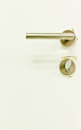 door knob: White door knob is made of stainless steel Stock Photo