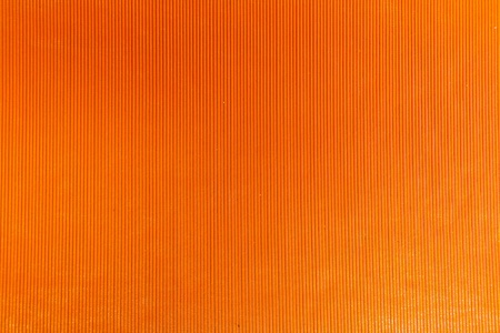 Orange leather with a small pattern is a vertical photo