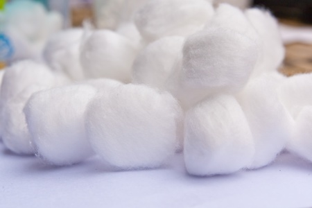 A cotton ball several overlapping pieces on write background photo