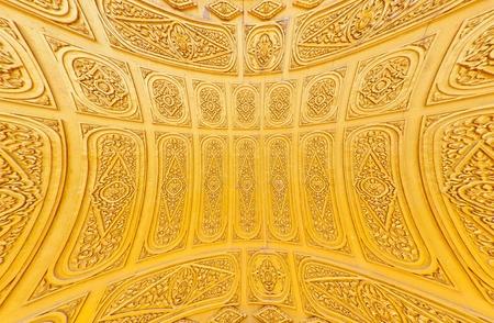 Golden Thai style pattern design handcraft on wood photo