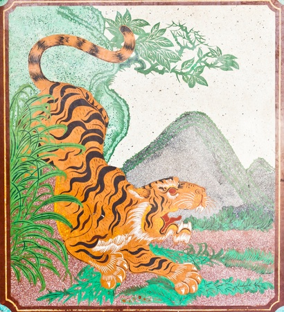 wild asia: Drawing a tiger on the wall in a Chinese temple