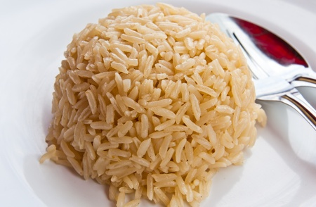 black rice: White rice on a plate, spoon on the side