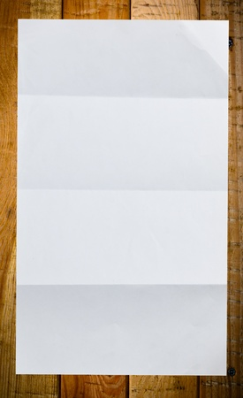 Sheet of white paper on wood background texture photo
