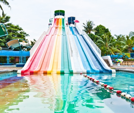 slider: Slider in a variety of colors in the water park Stock Photo