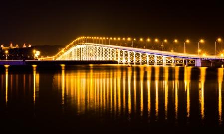 macau: The bridge across the island at night on the island of Macao