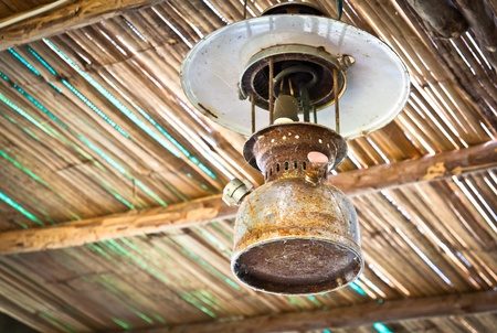Antique hurricane lamps hanging on the ceiling of bamboo Stock Photo - 11904359