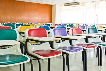 empty classroom: Multi-colored chairs arranged in the room