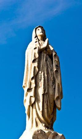 maria: Virgin Mary statue and the blue sky Stock Photo