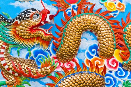 The golden dragon on the wall photo