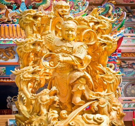 Golden statues of Chinese gods photo