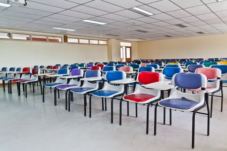 Multi colored chairs arranged in the room