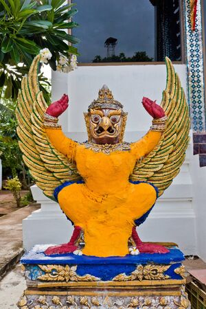 Garuda statue in the corner of temple photo