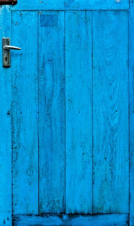 The doors made of wood painted blue photo