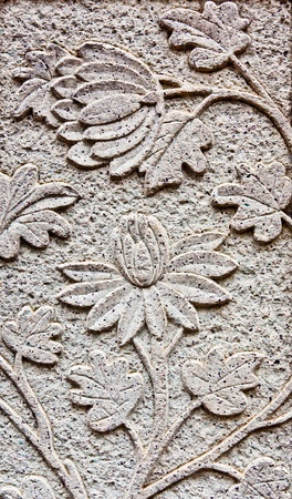 Flower carved on the temple wall photo