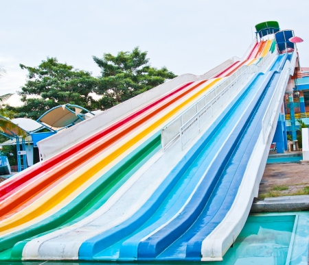 Slider in a variety of colors in the water park photo