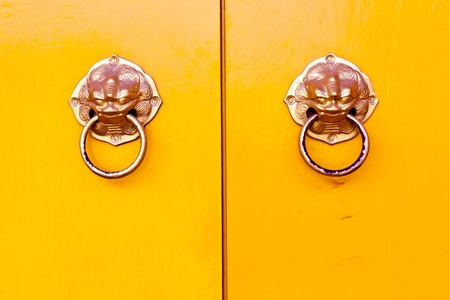 The yellow doors and door handles a lion Stock Photo - 12916737