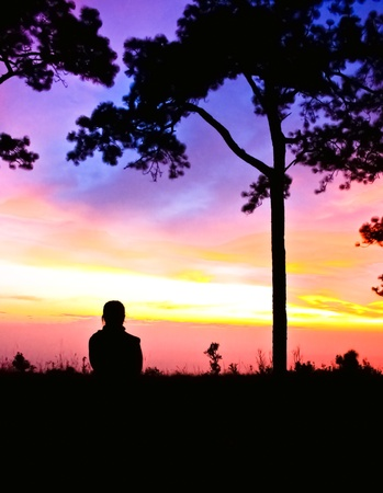 Woman standing looking at a beautiful sunset sky Stock Photo - 12916725
