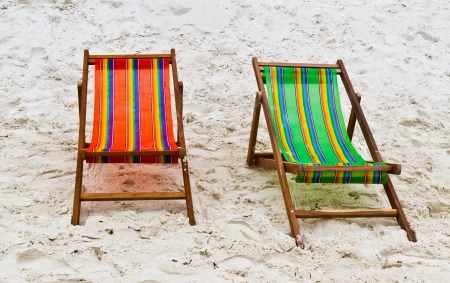 Chairs on the sand beside the sea photo