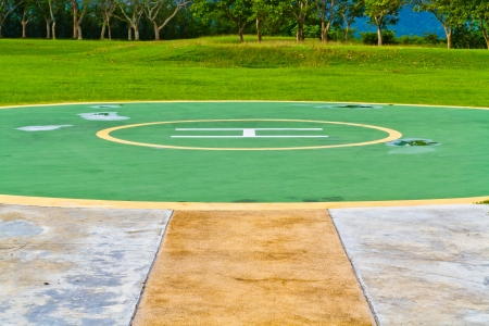 heliport: Helicopter landing pad  a circular in lawn