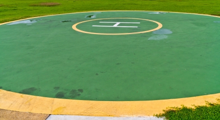helicopter pad: Helicopter landing pad  a circular in lawn