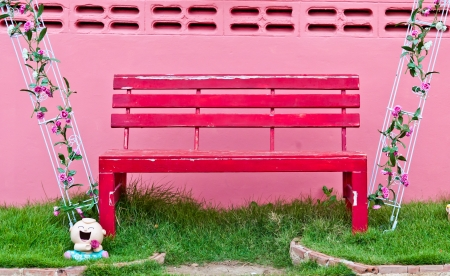 The red chair with pink walls photo