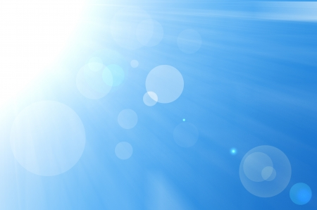 Sky background with sun burst and lens flare.  Stock Photo