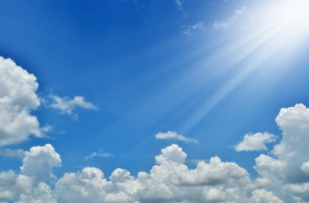 sunbeam: Blue sky with clouds and sun.  Stock Photo