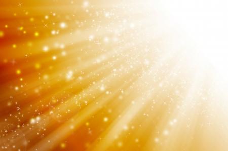 milagro: estrella de luz con fondo de oro. Foto de archivo