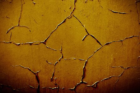 yellow grunge background with old peeling paint  photo
