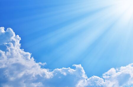 Blue sky with clouds and sun.  photo