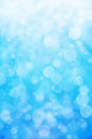 abstract light bokeh on blue background. photo