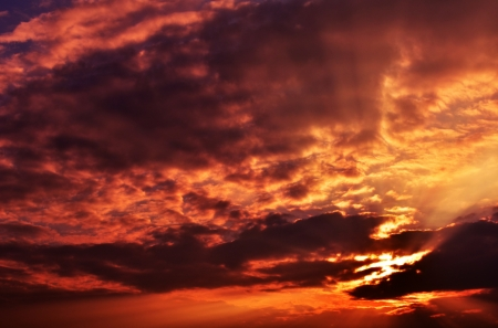 Sunset / sunrise with clouds, light and rays. Stock Photo - 17418390