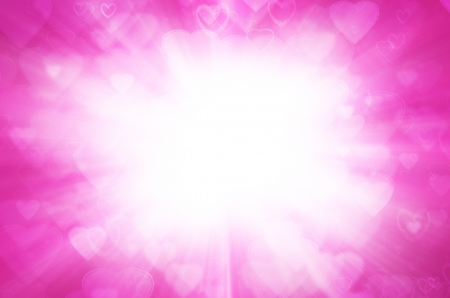 Abstract pink background with light of heart. photo