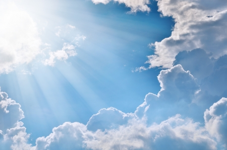 Blue sky with clouds and sunlight.