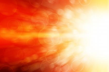 赤色光とサークルの抽象的な背景