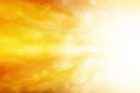 黄色の光とサークルの抽象的な背景